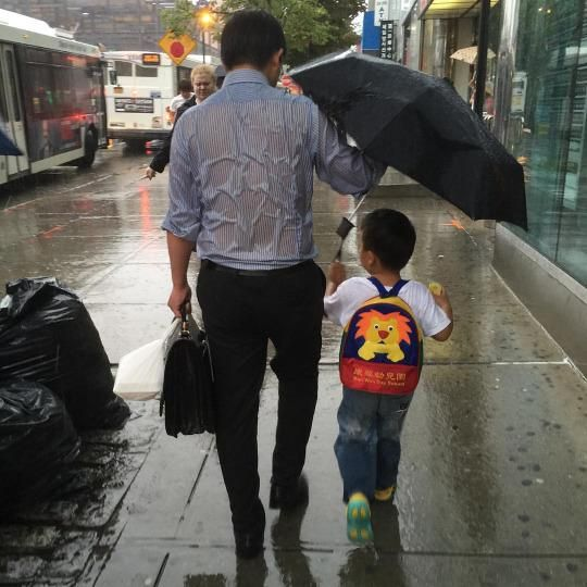https://www.yahoo.com/parenting/story-behind-photo-of-umbrella-dads-touching-129154929302.html