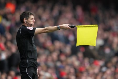 Assistant referee Andy Garratt flags for offside