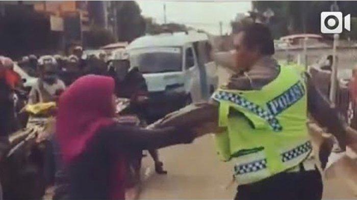 dora-terekam-video-amatir-menyerang-petugas-polisi_20161213_203020